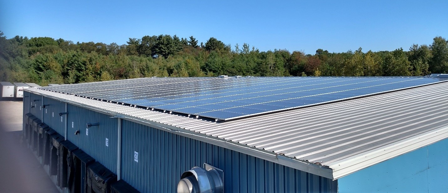 Photograph taken by William Borek, Operations Director of Braun's Express. The photo shows half of the newly installed solar panels on the rear portion of roof on the warehouse of the Braun's Express terminal in Hopedale, MA.